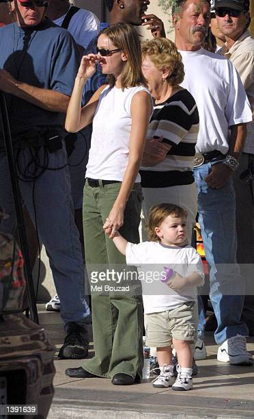Actress Calista Flockhart and her son Liam watch her boyfriend actor Harrison Ford film a scene for his upcoming movie Two Cops on September 17 2002...