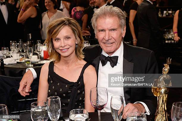 Actress Calista Flockhart and honoree Harrison Ford pose with the the Albert R Broccoli Britannia Award for Worldwide Contribution to Entertainment...