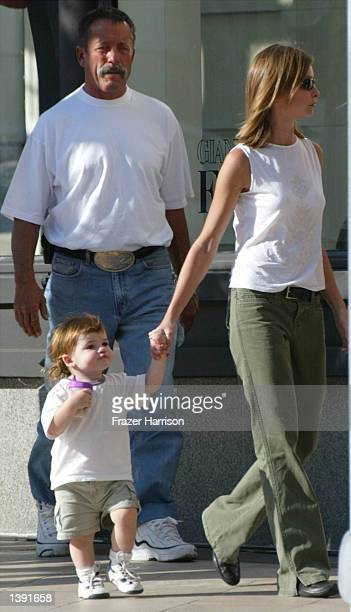 Actress Calista Flockhart and son Liam walk on the set of her boyfriend actor Harrison Ford's upcoming movie Two Cops on Rodeo Drive on September 17...