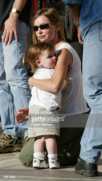 Actress Calista Flockhart hugs her son Liam on the set of her boyfreind actor Harrison Ford's upcoming movie Two Cops on Rodeo Drive on September 17...