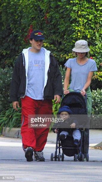 Actress Calista Flockhart walks with her son Liam and personal trainer Jamie Milnes December 1 2001 in Brentwood CA