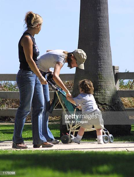Actress Calista Flockhart with her son Liam and an unidentified woman spend time in the park on July 24 2002 in Santa Monica California