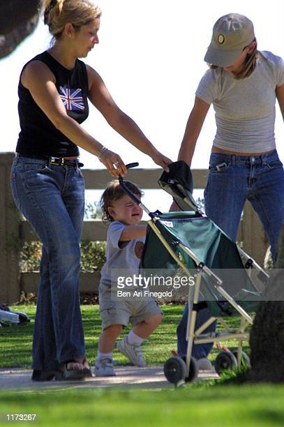 Actress Calista Flockhart with her son Liam and unidentified woman spend time in the park on July 24 2002 in Santa Monica California