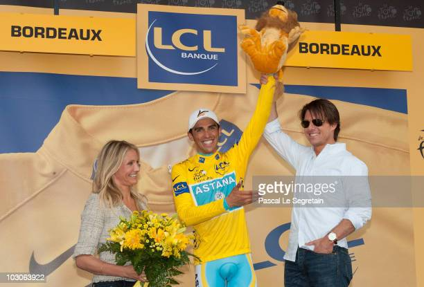 Actress Cameron Diaz and Actor Tom Cruise stand on the podium with cyclist Alberto Contador after he was presented the yellow jersey at the...
