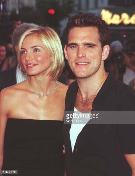 """Actress Cameron Diaz and her actor-boyfriend Matt Dillon arrive for the premiere of their new film """"There's Something About Mary"""" 09 July in..."""
