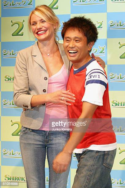 """Actress Cameron Diaz and Japanese actor Masatoshi Hamada pose at a photo session during a press conference to promote """"Shrek 2"""" on July 13, 2004 in..."""