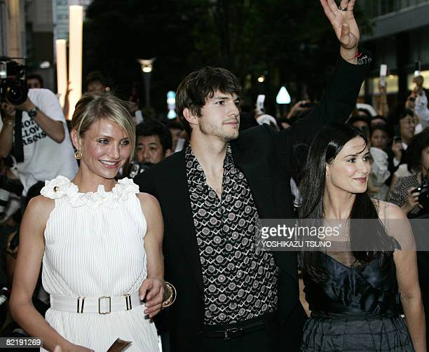 US actress Cameron Diaz and US actor Ashton Kutcher accompanied by his wife Demi Moore arrive at Japan premier of their latest movie What Happens in...