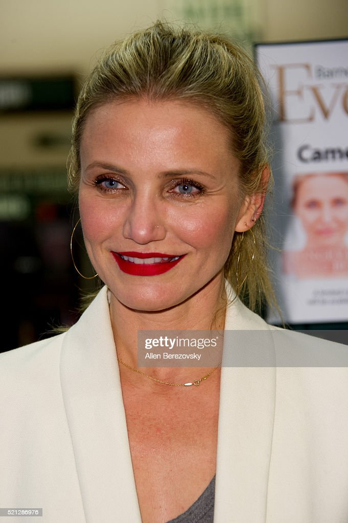 Actress Cameron Diaz poses for pictures during the signing of her book 'The Longevity Book: The Science of Aging, The Biology of Strength, and the Privilege of time' event at Barnes & Noble on April 14, 2016 in Huntington Beach, California.