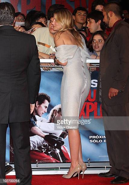 "Actress Cameron Diaz poses with fans and signs autographs during the premiere of ""Knight & Day"" at Cinemex Santa Fe on July 7, 2010 in Mexico City,..."