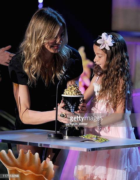 Actress Cameron Diaz presents the Best Line From A Movie award to actress Alexys Nycole Sanchez onstage during the 2011 MTV Movie Awards at Universal...