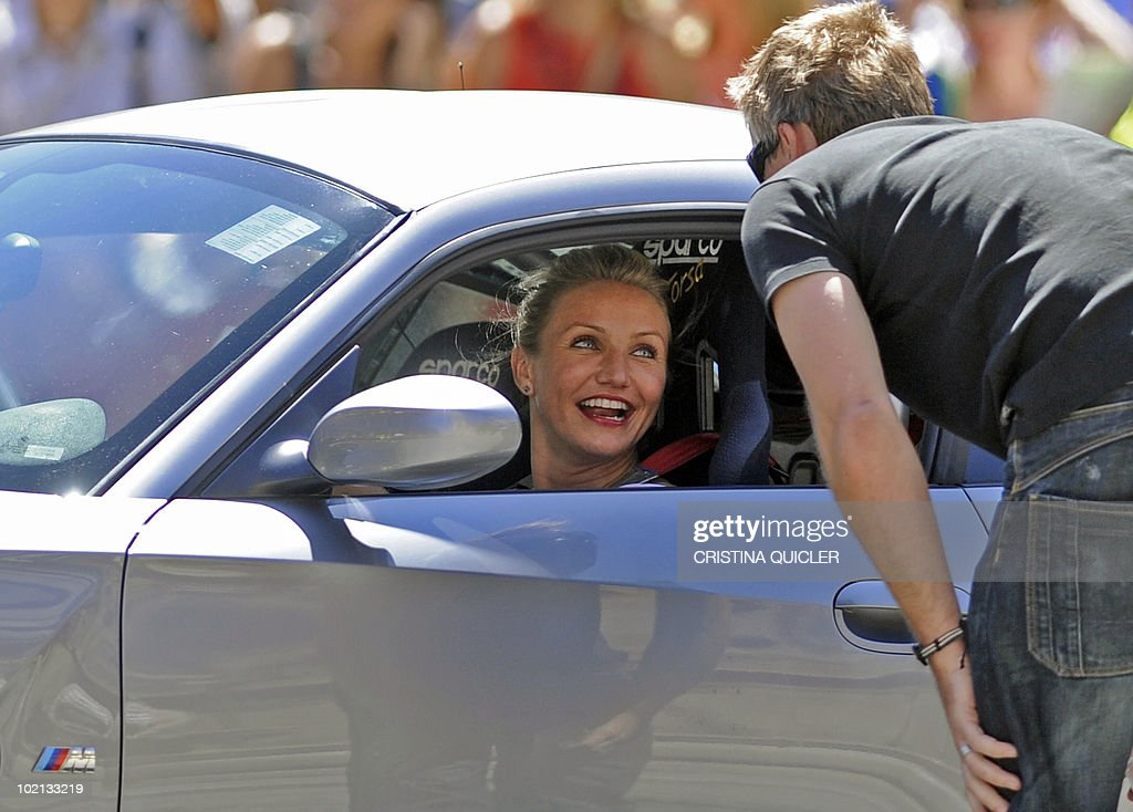 US actress Cameron Diaz rides a car in Sevilla on June 16, 2010, to recreate scenes from the film 'Knight and Day' by US director James Mangold. US actors Tom Cruise and Cameron Diaz arrive in Sevilla to attend the international premiere of Mangold's new film.