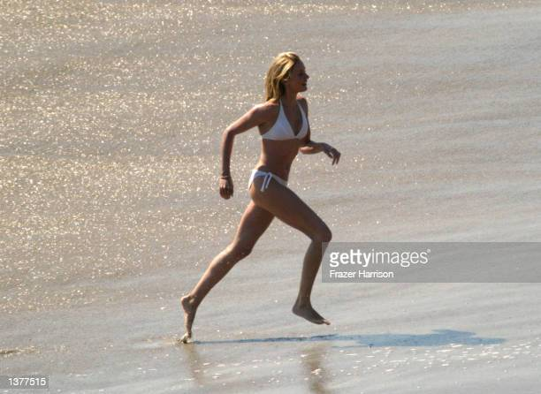 Actress Cameron Diaz runs on the set of her upcoming movie Charlie's Angels 2 on September 10 2002 in Malibu California