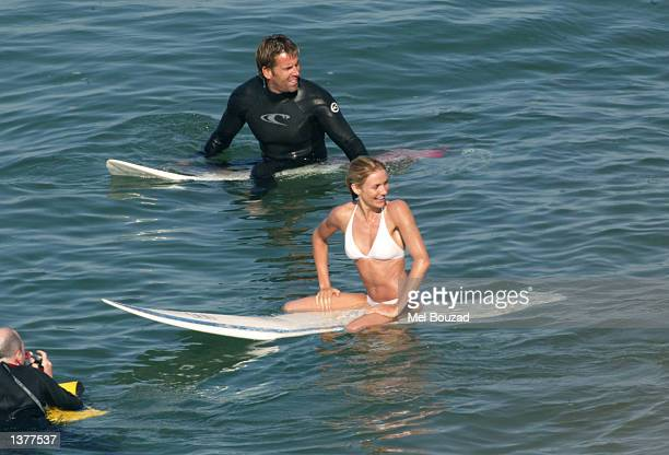Actress Cameron Diaz surfs on the set of her upcoming movie 'Charlie's Angels 2' on September 10 2002 in Malibu California