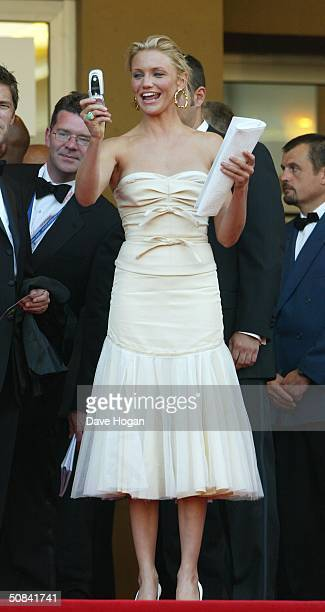 Actress Cameron Diaz takes a photograph at the Premiere of movie Shrek 2 at Le Palais de Festival on May 15 2004 in Cannes France