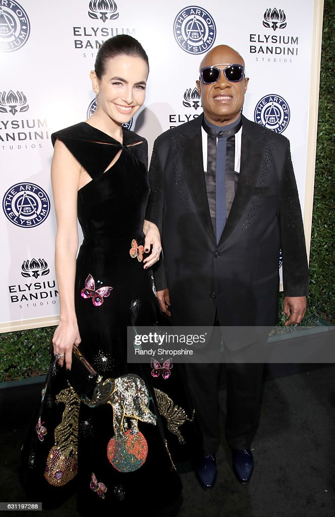 Actress Camilla Belle, and musician Stevie Wonder attend The Art of Elysium presents Stevie Wonder's HEAVEN - Celebrating the 10th Anniversary at Red Studios on January 7, 2017 in Los Angeles, California.