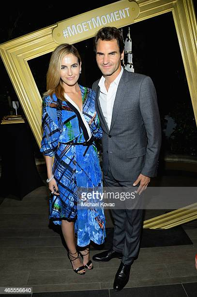 Actress Camilla Belle and tennis player Roger Federer attend the Moet Chandon toast to honor brand ambassador Roger Federer's historymaking 1000th...