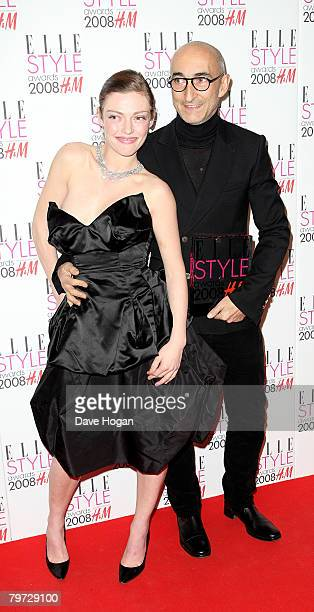 Actress Camilla Rutherford and Pierre Hardy pose with the latter's Best Accessory Designer Award in the press room at the Elle Style Awards at The...