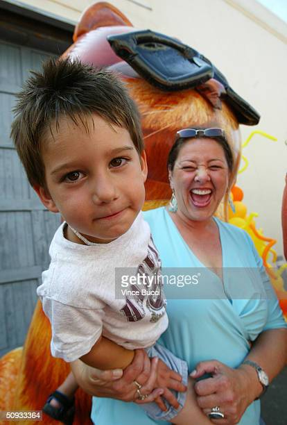 Actress Camryn Manheim and son Milo attend the premiere of the the film Garfield The Movie on June 6 2004 at the Twentieth Century Fox studio lot in...