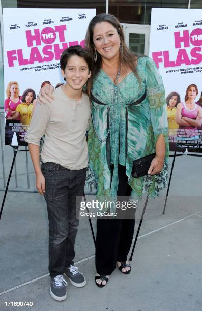 Actress Camryn Manheim and son Milo Manheim arrive at the Los Angeles premiere of The Hot Flashes at ArcLight Cinemas on June 27 2013 in Hollywood...