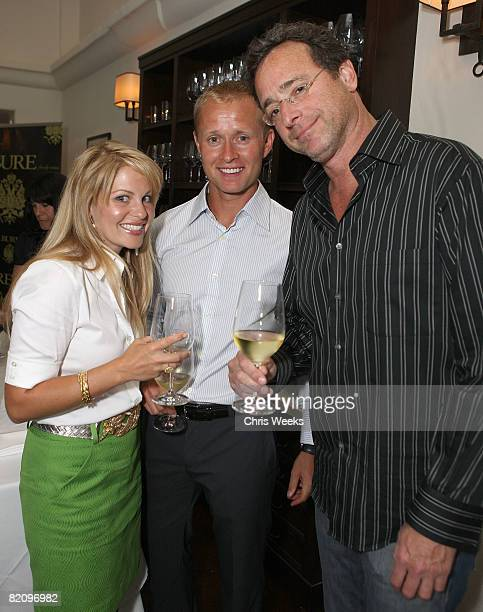 Actress Candace Cameron Bure NHL player Valeri Bure and actor Bob Saget attend the release of Bure Family Wines at Campanile on July 28 2008 in Los...
