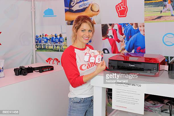 Actress Candace Cameron Bure tests the Canon PIXMA MG7720 in the Canon booth at the Little League World Series on August 21 2016 in South...