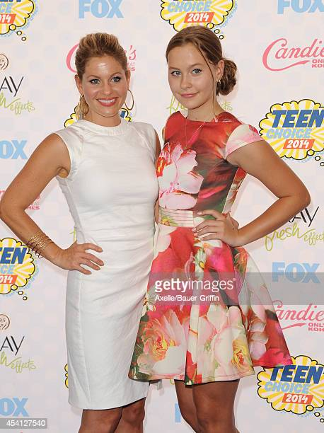 Actress Candace CameronBure and daughter Natasha Valerievna Bure arrive at the 2014 Teen Choice Awards at The Shrine Auditorium on August 10 2014 in...
