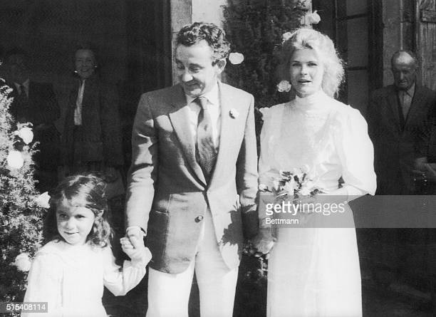 Actress Candice Bergen and French movie director Louis Malle after their wedding in the small village of Lugagnac Malle holds hand of this daughter...