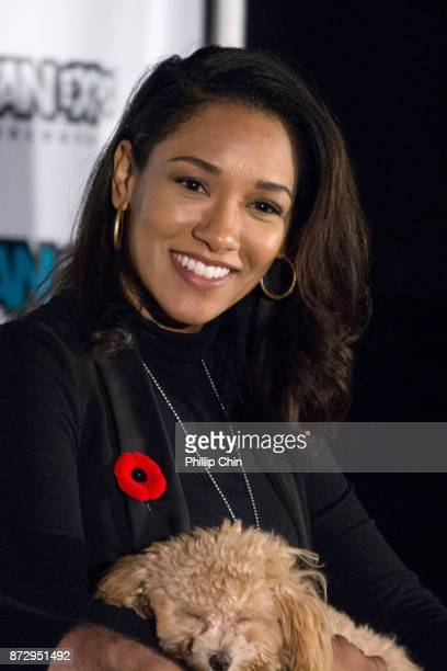 Actress Candice Patton and her dog Zoe attend 'The Flash QA at Fan Expo Vancouver in the Vancouver Convention Centre on November 11 2017 in Vancouver...