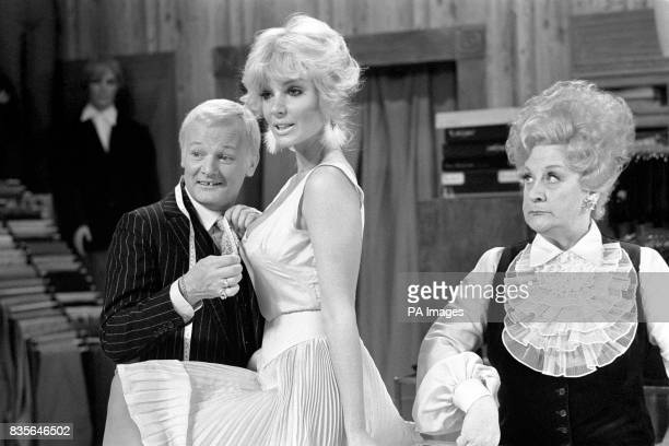 Actress Candy Davis gets the Are You Being Served treatment from John Inman and Mollie Sugden during rehearsals