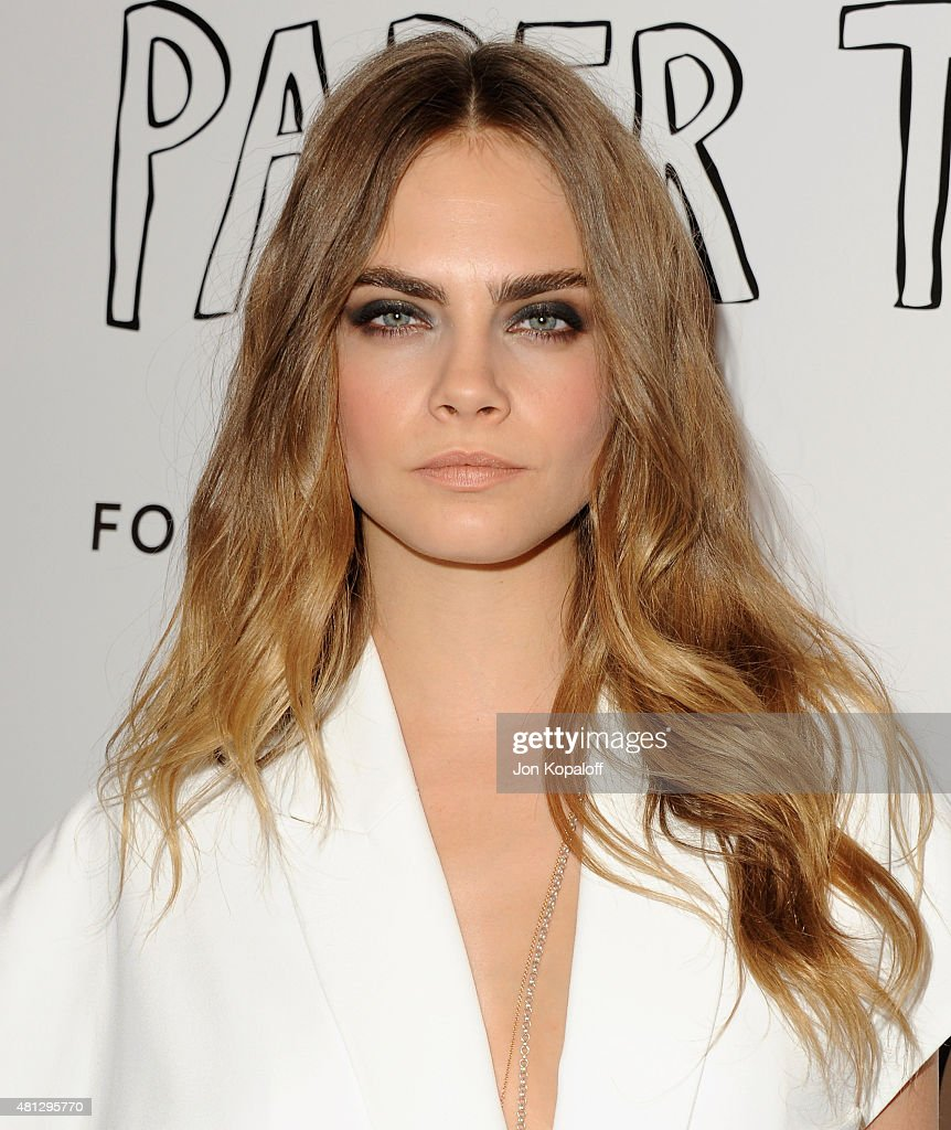 Actress Cara Delevingne arrives at the Screening Of 20th Century Fox's 'Paper Towns' at The London West Hollywood on July 18, 2015 in West Hollywood, California.