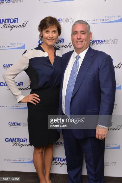 Actress Carey Lowell and CEO of Cantor Fitzgerald Shawn Matthews participate in Annual Charity Day hosted by Cantor Fitzgerald BGC and GFI at Cantor...