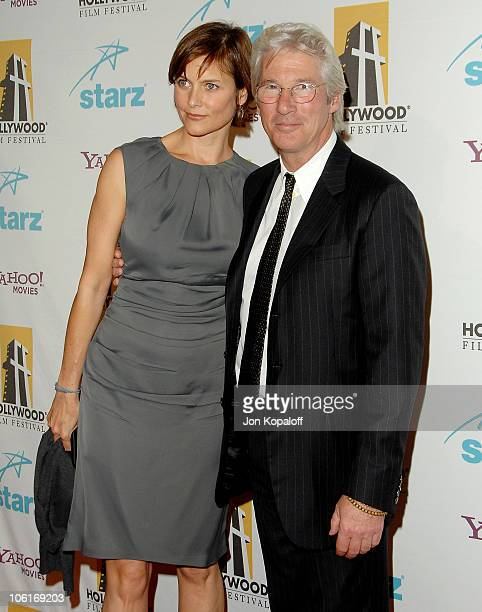 Actress Carey Lowell and husband actor Richard Gere arrive at the Hollywood Film Festival's Hollywood Awards at the Beverly Hilton Hotel on October...