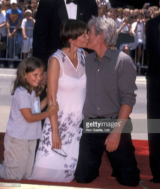 Actress Carey Lowell daughter Hannah Dunne and actor Richard Gere attend Richard Gere's hands and footprints in cement ceremony on July 26 1999 at...
