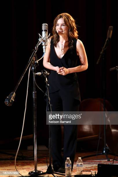 Actress Carey Mulligan speaks on stage before performing with Gillian Welch and Rhiannon Giddens during the onenightonly concert 'Another Day Another...
