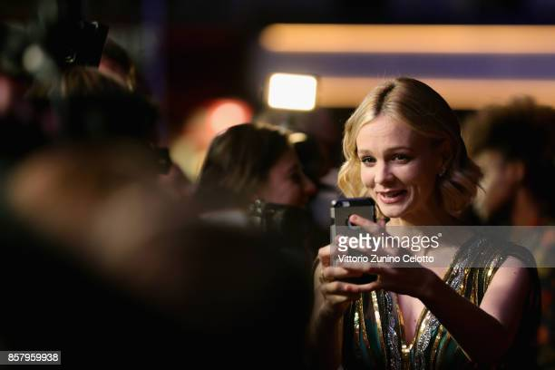 Actress Carey Mulligan talks to a reporter as she attends the Royal Bank of Canada Gala European Premiere of 'Mudbound' during the 61st BFI London...