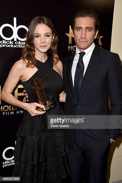 Actress Carey Mulligan winner of the Hollywood Actress Award for 'Suffragette' poses with actor Jake Gyllenhaal in the press room during the 19th...