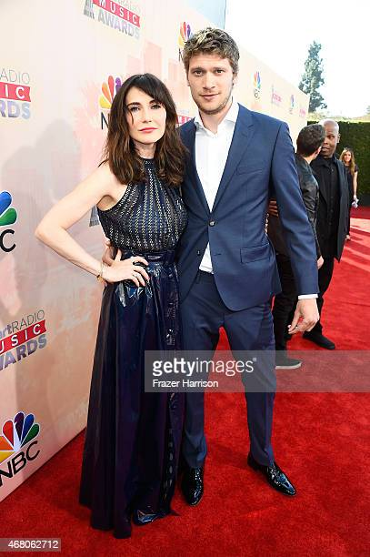 Actress Carice van Houten and Kees van Nieuwkerk attend the 2015 iHeartRadio Music Awards which broadcasted live on NBC from The Shrine Auditorium on...