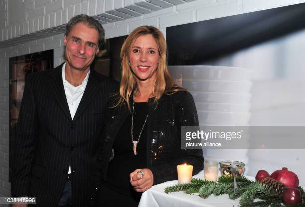 Actress Carin C Tietze and her husband director Florian Richter attend the XMAS Cocktail event at Kaefers Atelier in Munich Germany 08 December 2016...