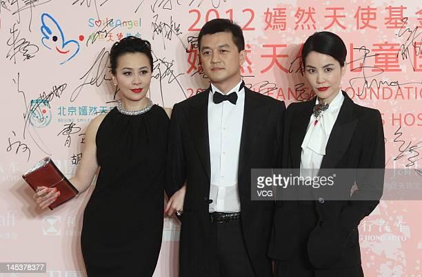 Actress Carina Lau actor Li Yapeng and singer Faye Wong attend the Yanran Angel Foundation charity dinner at China World Summit Wing on May 27 2012...