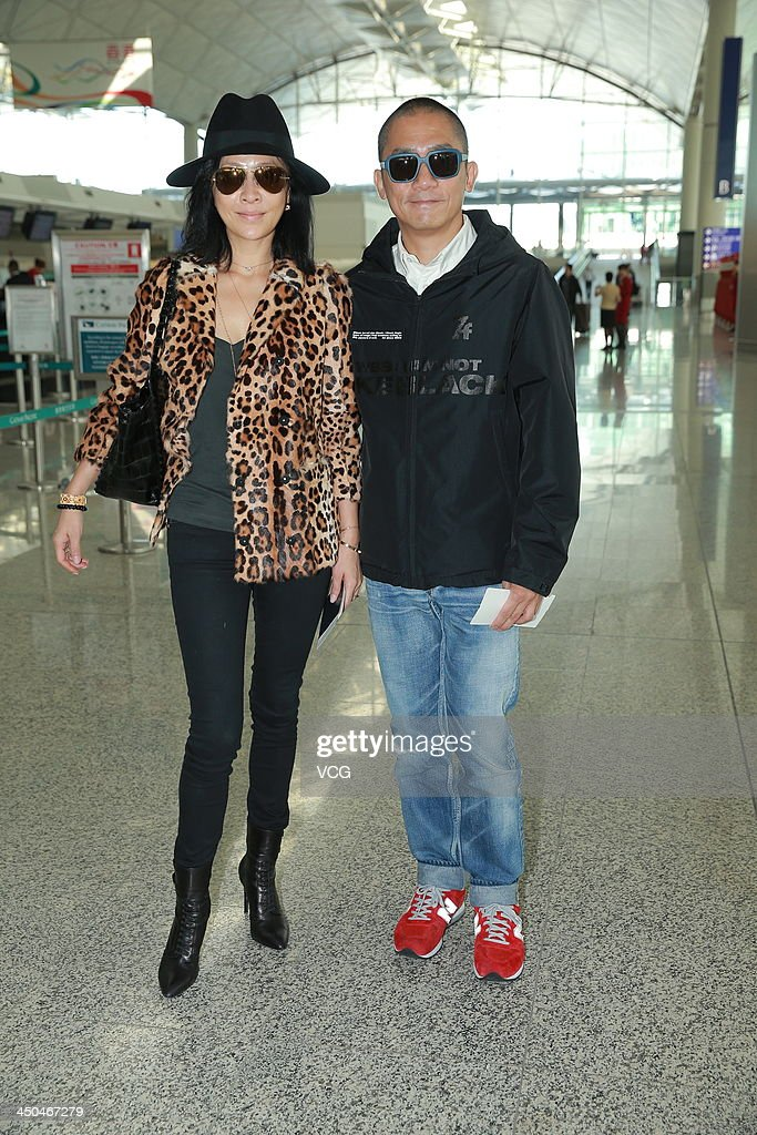 Actress Carina Lau and her husband Tony Leung Chiu-Wai arrive at Hong Kong airport ahead of Chang Chen's wedding ceremony on November 18, 2013 in Hong Kong, Hong Kong.