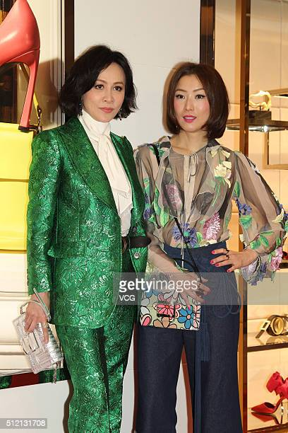 Actress Carina Lau and singer Sammi Cheng attend a reception party for an opening event of Roger Vivier on February 24 2016 in Hong Kong China