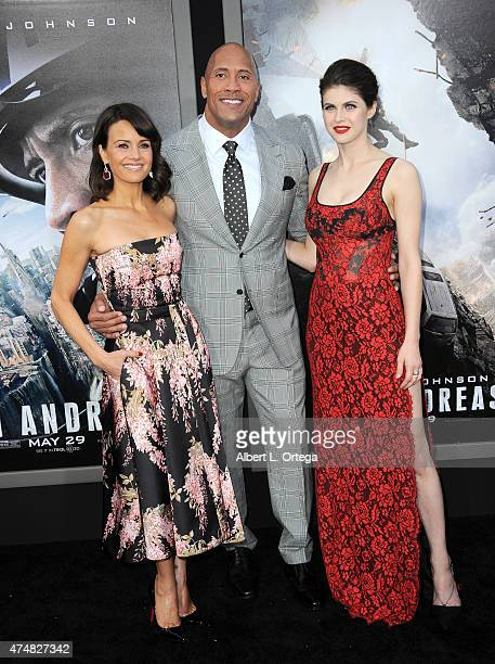 "Actress Carla Gugino, actor Dwayne Johnson and actress Alexandra Daddario arrive for the Premiere Of Warner Bros. Pictures' ""San Andreas"" held at TCL..."