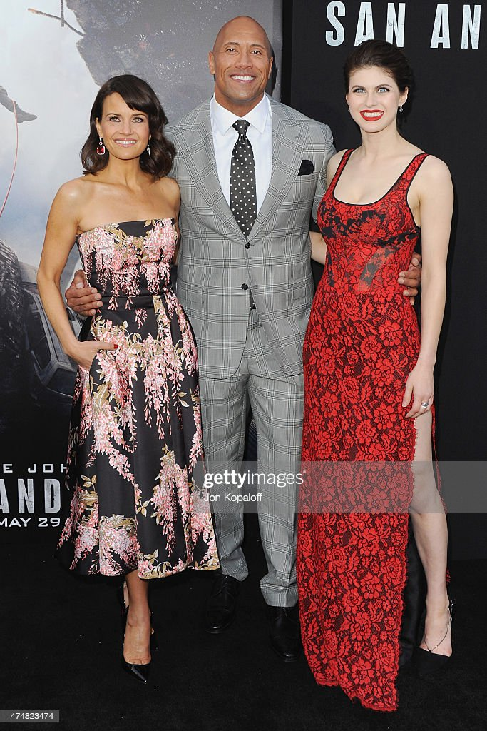 Actress Carla Gugino, actor The Rock and actress Alexandra Daddario arrive at the Premiere Of Warner Bros. Pictures' 'San Andreas' at TCL Chinese Theatre on May 26, 2015 in Hollywood, California.