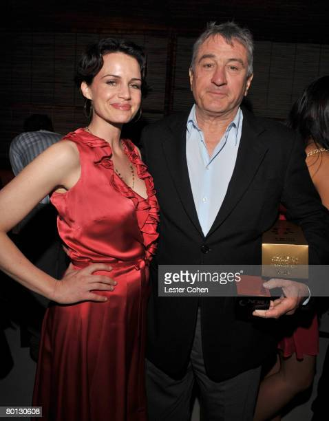 Actress Carla Gugino and owner Robert De Niro attend the opening sake ceremony of Nobu Los Angeles on March 4 2008 in West Hollywood California