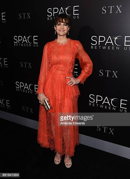 Actress Carla Gugino arrives at the premiere of STX Entertainment's 'The Space Between Us' at ArcLight Hollywood on January 17 2017 in Hollywood...