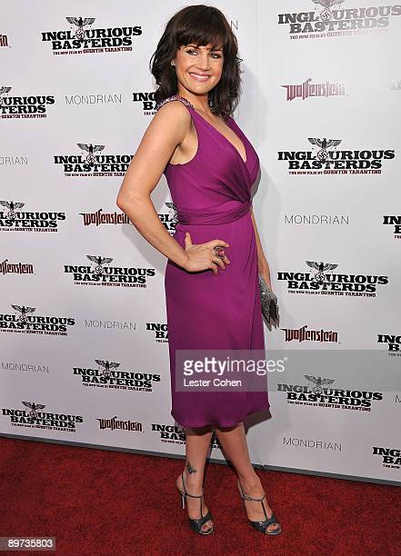 Actress Carla Gugino arrives on the red carpet of the Los Angeles premiere of Inglourious Basterds at the Grauman's Chinese Theatre on August 10 2009...