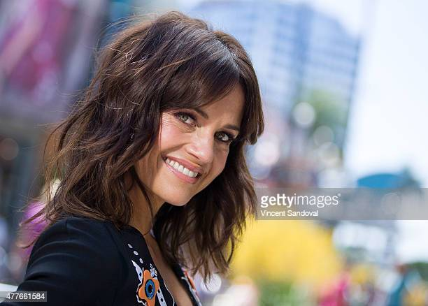 Actress Carla Gugino attends 'Extra' at Universal Studios Hollywood on June 18 2015 in Universal City California