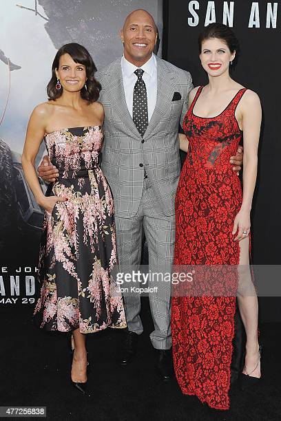 """Actress Carla Gugino, Dwayne """"The Rock"""" Johnson and actress Alexandra Daddario arrive at the Premiere Of Warner Bros. Pictures' """"San Andreas"""" at TCL..."""