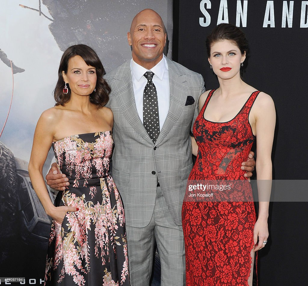 Actress Carla Gugino, Dwayne 'The Rock' Johnson and actress Alexandra Daddario arrive at the Premiere Of Warner Bros. Pictures' 'San Andreas' at TCL Chinese Theatre on May 26, 2015 in Hollywood, California.