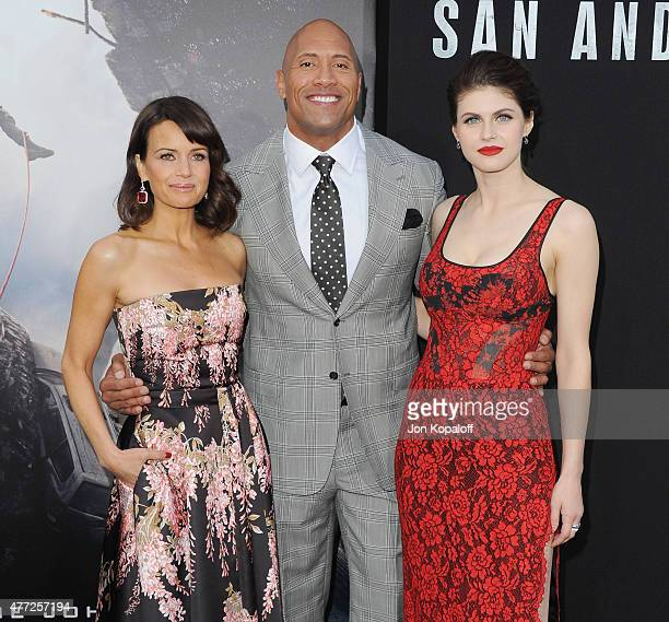Actress Carla Gugino Dwayne 'The Rock' Johnson and actress Alexandra Daddario arrive at the Premiere Of Warner Bros Pictures' 'San Andreas' at TCL...
